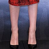Kristen accessorized with classic Christian Louboutin pumps.