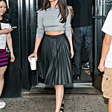 Fall staple: A fuzzy gray crop knit top from Topshop. Selena wore it with: A pleated Topshop skirt, Dior sunglasses, and open-toed Kurt Geiger sandals in New York in August 2015.