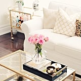 The find: the black and gold tray that completes this coffee table.
