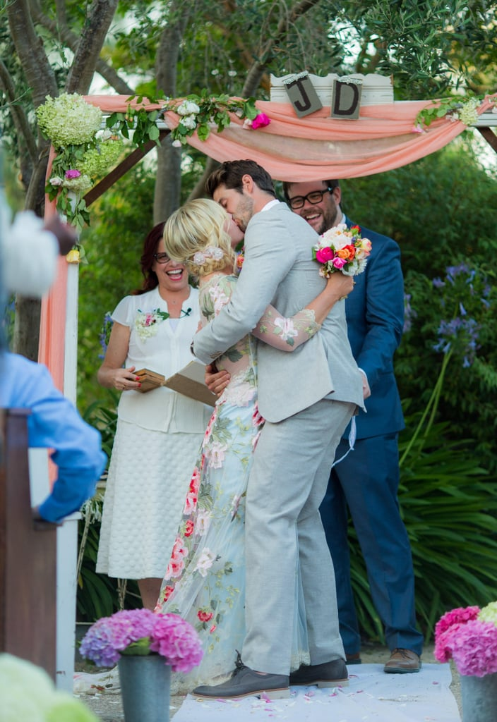 """Jennie Garth married Dave Abrams in a gorgeous outdoor event in Los Olivos, CA, on July 11, and now the couple is sharing stunning pictures from their big day! The ceremony and reception took place on Jennie and Dave's property, which Jennie called """"so pretty and private and intimate."""" Guests dined on fried chicken and cheesy grits and enjoyed pies for dessert while cocktail options included a """"moonshine mojito"""" and a """"drunken Arnold Palmer."""" Jennie, who worked with event planner and friend Landi Stone, """"wanted the vibe to be intimate, easy, and sweet."""" From the images, it's clear the results were gorgeous.  Jennie and Dave, who met on a blind date in December 2014, included Jennie's three children from her marriage to Peter Facinelli in the festivities, and Jennie's pal, Tori Spelling, was also on hand to show her support. Jennie wore a unique floral gown by Claire Pettibone while her daughters were dressed in different soft shades. Scroll through to see all the pictures from Jennie and Dave's wedding and then see all the famous couples that have gotten married this year."""