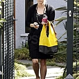 Reese Witherspoon carried a black and yellow bag leaving a friend's house in LA.