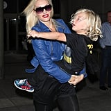Gwen Stefani carried Zuma Rossdale through LAX in his Batman gear.
