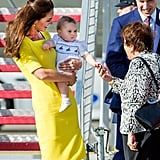 Kate Middleton held Prince George in her arms after the royals landed in Australia during their tour.