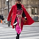 A Red Coat, Pink Dress Worn Over a Black Turtleneck Jumper, and Black Boots
