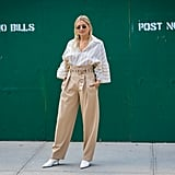 Tucked Into a Pair of Paper Bag Trousers With Glove Pumps, Like Danielle Bernstein