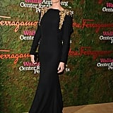 Charlize was glowing in Alexander McQueen's shoulder-embellished, open-back gown.