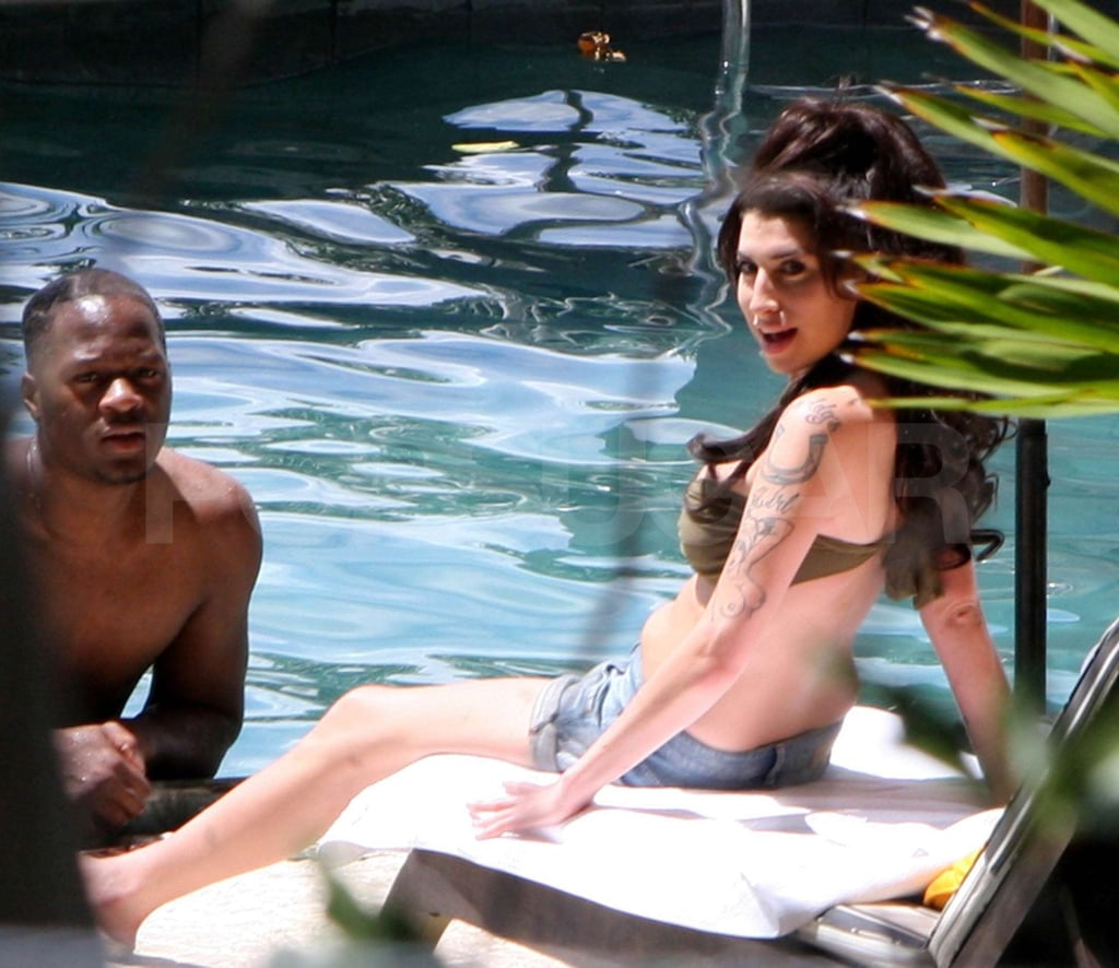 Amy Winehouse relaxed poolside in a bikini with her backing singer Zalon in Rio de Janeiro this week. The singer has been enjoying the sun during her stay in Brazil, where she performed a comeback gig at the weekend. She's reportedly making time for romancee too, and looks well rested on her week away. When she returns to the UK, Amy will be able to keep the good times rolling, as she's reportedly planning to record a duet Tony Bennett.