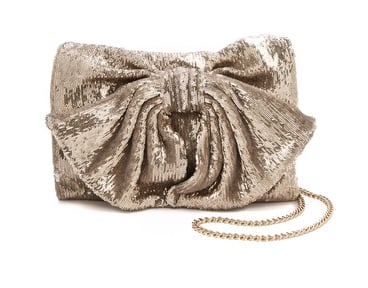 This RED Valentino sequined bow clutch ($395), which also comes in pink and black, is begging to be worn to a holiday party.