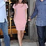 Victoria Beckham in a pink dress.
