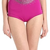 The signature on the Versace Crystal Logo Studded One Piece Swimsuit ($349) isn't just iconic, it's playful.