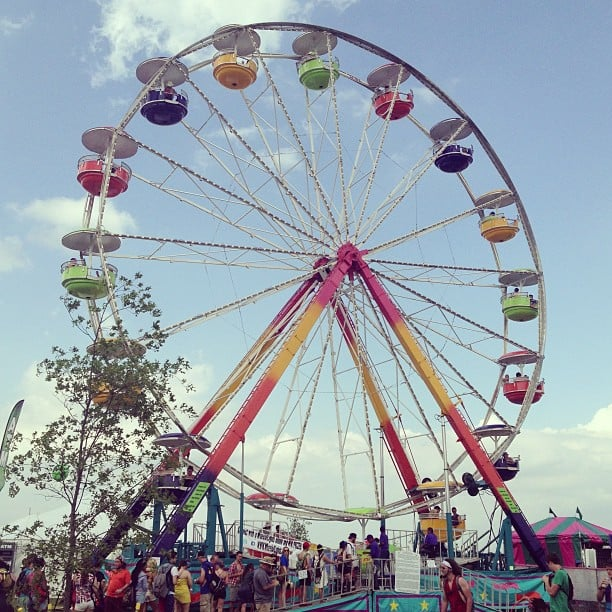 """One of Bonnaroo's core attractions is the Wheel of Lights (it's commonly referred to as """"Woli""""). The Ferris wheel is a great way to see the entire campground — plus, it's one of the best ways to stay cool; the breezes are amazing! Source: Instagram user popsugarfashion"""