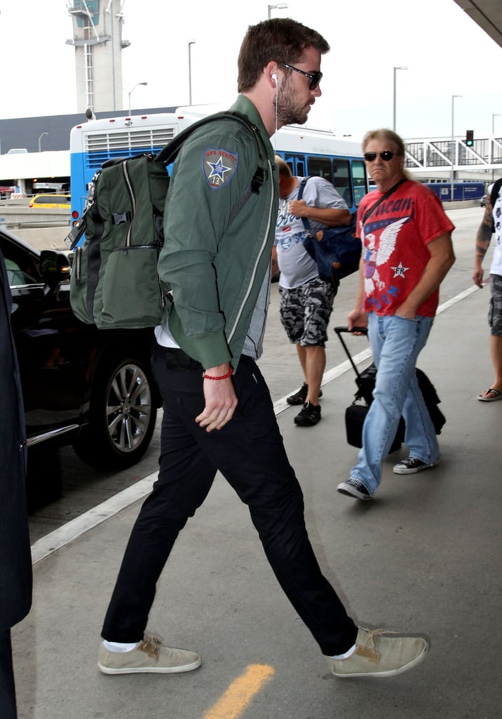 Liam Hemsworth wore a green jacket to travel out of LAX.
