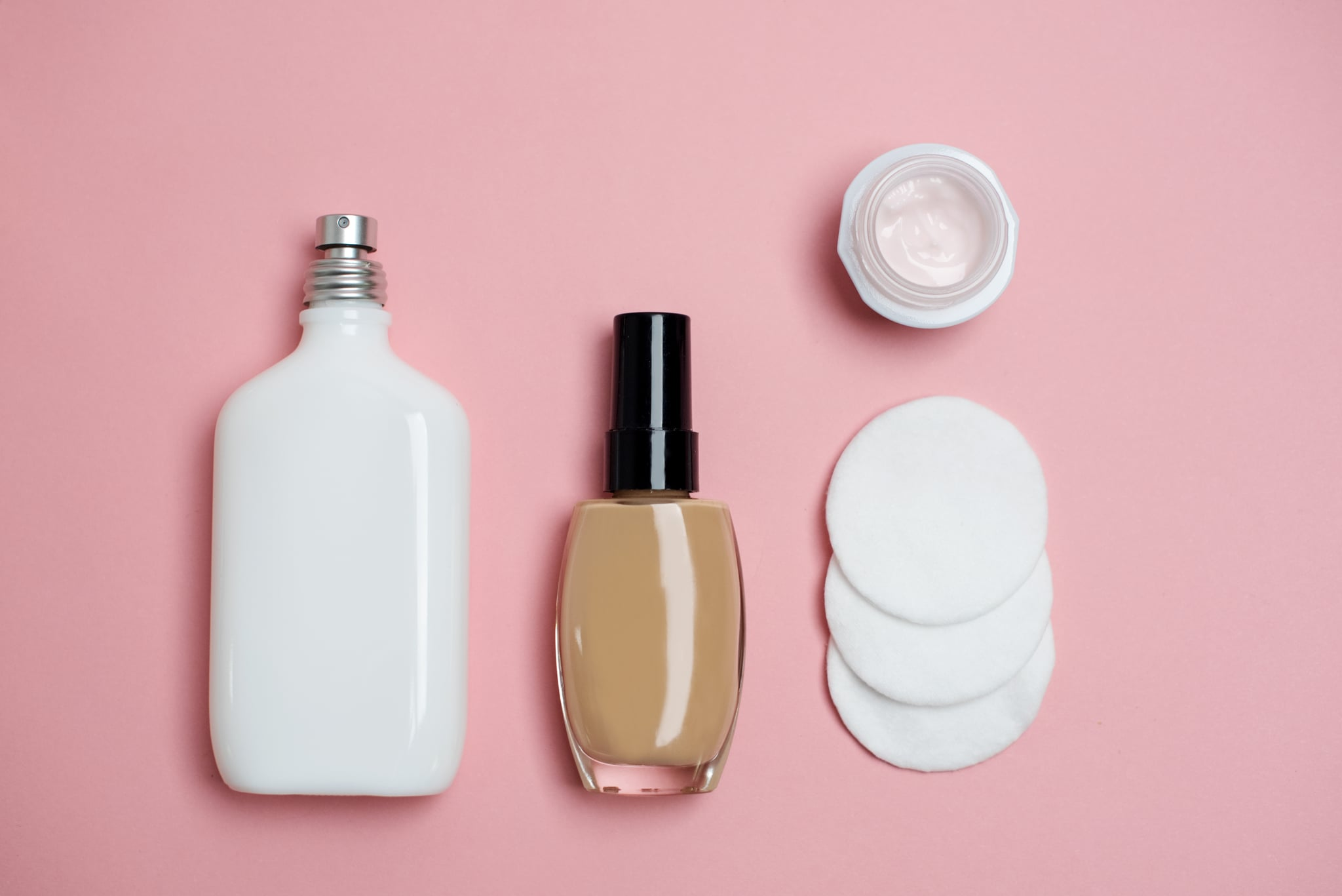 Variety of beauty products on pink background