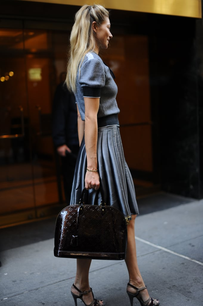Jessica Hart posed in monochromatic pleats and sky-high heels.