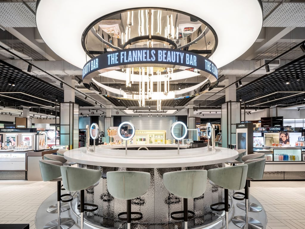 """Flannels Beauty has landed, and beauty shopping has never been more luxurious — trust us, it's got everything you could wish for in a beauty shopping destination.  The Flannels beauty vision was born due to the lack of luxury beauty in the UK outside of London. That's why the first Flannels in-store beauty destination is in Sheffield Meadowhall opening on 19 July. Don't expect to find any regular beauty hall, though. The Flannels """"beauty haul"""" comprises multiples brands from varying price points, including Charlotte Tilbury, La Labo, Morphe, Natasha Denona, Chanel, Gucci Beauty, Nudestix, and Augustinus Bader, in addition to Patrick Ta — the exclusive bricks-and-mortar stocklist of the brand.  With the aim of delivering an unbiased in-store beauty destination, you can also shop the latest beauty trends with advice and brand-neutral recommendations from Flannels beauty experts at the Beauty Bar with a coffee or fizz in hand.  If you need a little more of a personalised experience, you can take full advantage of the """"Beauty Starring You"""" personal shopping and concierge service, tailored to exactly your needs. And forget having to trapes around the store trying to find the tills — there's even an option to use an iPad instead of the tills.  What's more, the store has the world's first """"beauty changing rooms"""", which features a private space to test and trial beauty. Sheffield is just the beginning. Two more stores are set to open this year, the first in Leicester and the second in Liverpool — a huge 120,000-square-foot store coming in the autumn. Check out the new store ahead."""