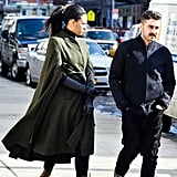 """Long leather opera gloves and a sleek overcoat-turned-poncho double up on minimizing cold-air """"intake."""""""