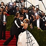 Cochairs Bradley Cooper and Sarah Jessica Parker stopped to greet each other on the stairs.