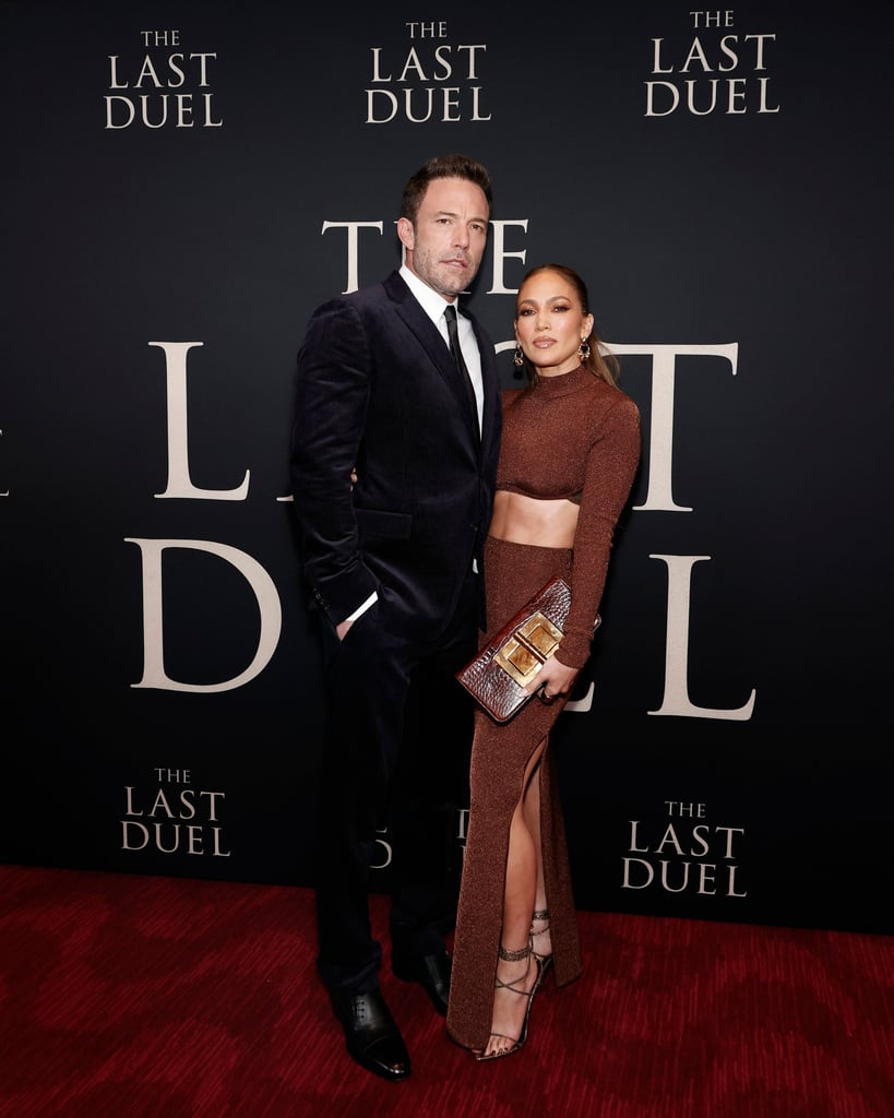 Ladies and gentlemen, please give it up for Bennifer. On Saturday night, Jennifer Lopez and Ben Affleck hit the red carpet together for the New York City premiere of The Last Duel, and all eyes were on J Lo and her perfectly toned obliques. Sorry, Ben, but when Jennifer pulled out this fabulously sparkly brown set from Hervé Léger, she knew the effect it would have on us. Styled by Rob Zangardi and Mariel Haenn, Jennifer's cropped mock turtleneck and slightly high-waisted skirt with a thigh-high slit matched perfectly with her brown Tom Ford clutch and Femme LA heels. She also wore gold Jennifer Fisher rings. It was a big night out for the couple, as Ben co-wrote and stars in The Last Duel, which hits theaters on Oct. 15. And we'd be remiss not to mention when Bennifer made their 2021 red carpet debut just last month at the movie's Venice Film Festival premiere, where J Lo wore a breathtaking white couture gown and she and Ben looked absolutely smitten with one another. Iconic. Now, we have this glamorous appearance from Ben and Jen featuring her flattering sparkly brown Hervé Léger set. Ahead, check out photos from the couple's night out and you'll understand why we can't get enough of J Lo's outfit.      Related:                                                                                                           The 17 Most Iconic J Lo and Ben Affleck Style Moments