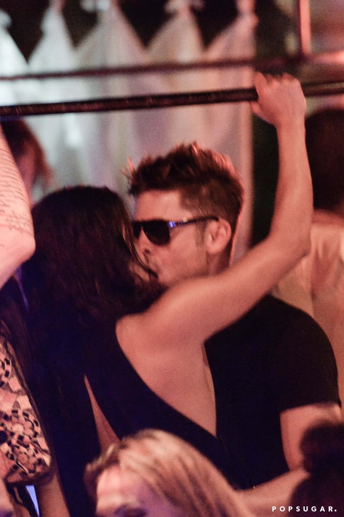 Zac Efron and Michelle Rodriguez have taken their friendship to the next level during their lavish Italian vacation that kicked off over the Fourth of July weekend. On Friday, the duo was spotted kissing and showing off PDA on a yacht in Sardinia, but their trip wasn't all about romance. They also did backflips off the boat and laughed together, which we saw in some videos that Michelle and their friend Gianluca Vacchi posted over the weekend. On Monday, the couple headed to a nightclub, where they kissed and danced in the crowd. We were just introduced to Zac and Michelle's friendship last week, and it definitely seems like they've been having fun. From Michelle doing headstands in her bikini to Zac dancing up a storm, they've provided endless entertainment so far.  We'll have to wait and see if their potential Summer fling blossoms into a full-fledged relationship. Michelle was most recently linked to model Cara Delevingne — they were kissing on vacation in their bikinis back in March —and Zac was reportedly dating his Neighbors costar Halston Sage in April. Keep reading to see Zac and Michelle getting cozy on a yacht, and check out some more sexy beach PDA pictures while you're at it.