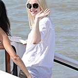 Dakota Fanning waved to cameras as she arrived by boat.