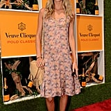 Poppy Delevingne wore a pretty floral sheath in soft pastels, but the coolest part of her outfit? Those superembellished gold glitter sandals.
