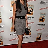 Simply stunning in a gray, one-shouldered mini for a book launch in October 2009.