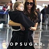 Harper Beckham cuddled close to Victoria Beckham.