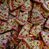 "Give your pup ""a pizza your heart"" with all-natural pizza treats. The crust is peanut butter dough, and what appear to be tiny bell peppers and cheese sprinkles are really yogurt chip decorations."
