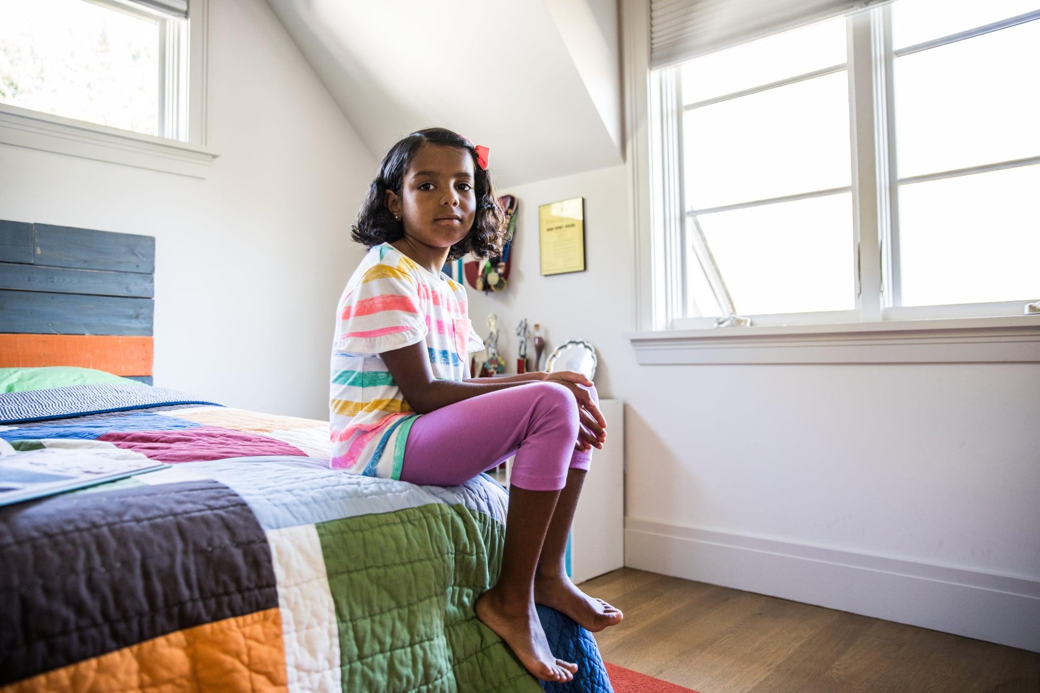 Girl sitting alone in her bedroom