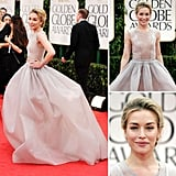 Piper Perabo wore a pale gray-lavender gown from the Theyskens' Theory Spring 2012 collection, and channeled Marilyn Monroe with twirls, kicks, and an ear-to-ear smile. She accessorized her stunning sheer gown with Tiffany & Co. diamonds and Christian Louboutin heels, and kept her hair and makeup quite minimal with a tousled updo and liquid eyeliner.