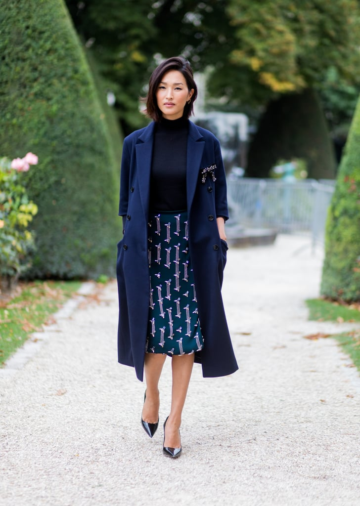 Just like how you can wear head-to-toe black, do head-to-toe navy. Street style star Nicole Warne makes this look easy by pairing together variations of the same colour, plus a print to mix it up.