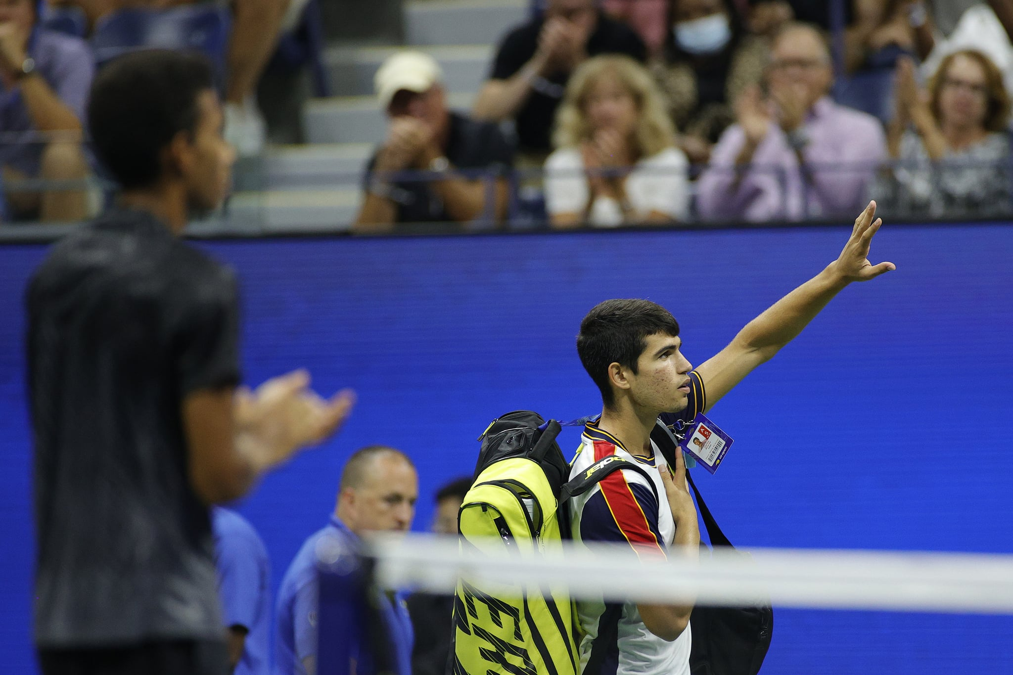NEW YORK, NEW YORK - SEPTEMBER 07: Carlos Alcaraz of Spain looks waves to the crowd as he leaves the court after retiring during his Men's Singles quarterfinals match against Felix Auger-Aliassime of Canada during on Day Nine of the 2021 US Open at the USTA Billie Jean King National Tennis Center on September 07, 2021 in the Flushing neighborhood of the Queens borough of New York City. (Photo by Sarah Stier/Getty Images)