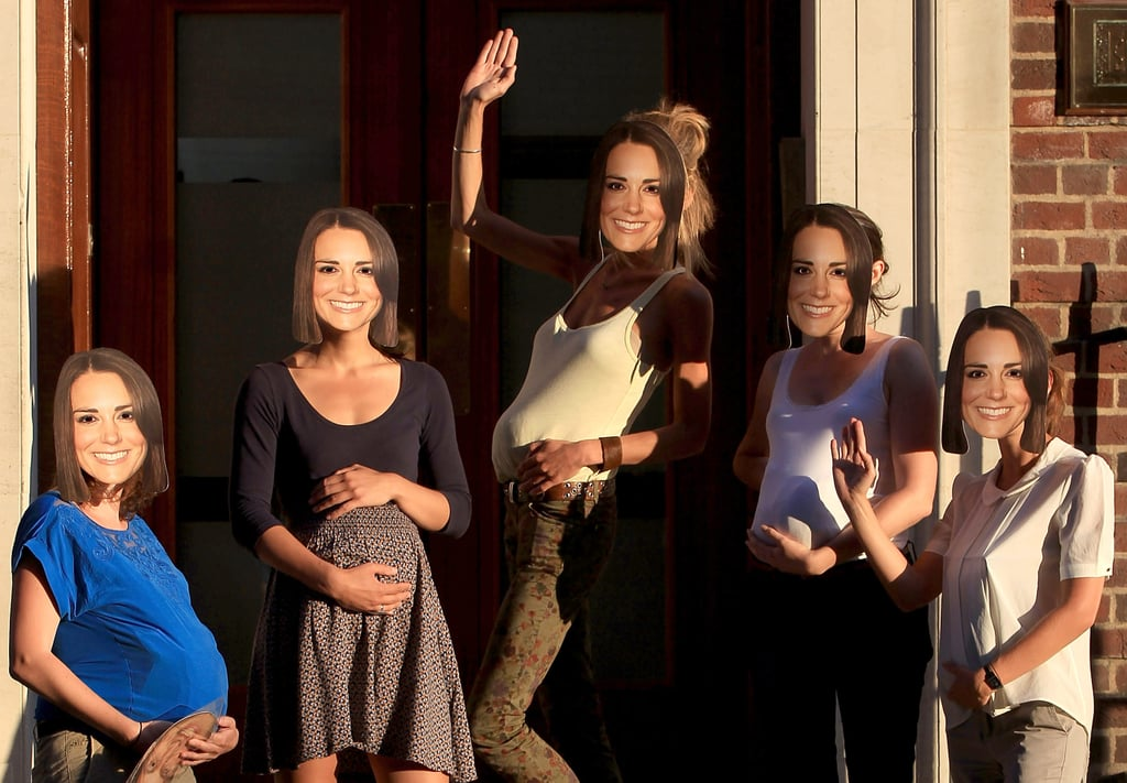 Girls wore Kate Middleton masks and fake baby bumps for a picture outside the hospital in London.