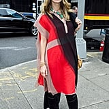 Angela Lindvall showed off a '70s style wearing a geometric print dress, black hat, and knee-high boots.