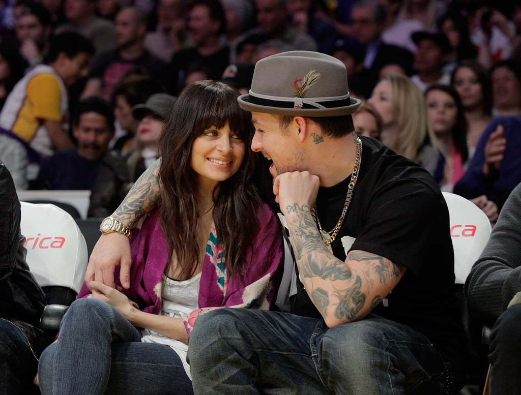 Nicole Richie and Joel Madden cuddled up during a Lakers game in December 2009.