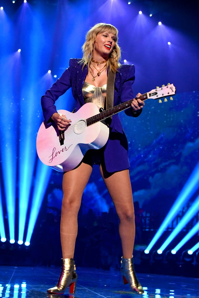 "Taylor Swift brought down the house as she performed at the MTV VMAs on Monday night. The singer opened the show with a colorful performance of ""You Need to Calm Down"" featuring hearts, rainbows, pink clouds, and a huge shout-out to the Equality Act at the end of her set. Reminiscent of the song's music video, Swift started the show in a yellow lawn chair (complete with fake grass) surrounded by backup dancers with brightly colored hair and matching outfits. The stage immediately transformed into a full-blown party, balloons included — not to mention, the pop-out letters on the screen were a total ""ME!"" callback. Swift threw on a sparkly blazer and followed ""You Need to Calm Down"" with her first live performance of ""Lover."" There was definitely a lot of love radiating off her friends in the audience, including Gigi Hadid and Camila Cabello. The crowd was also on board the love train as fans all throughout the venue cried and waved their hands along to the music. So sweet! The last time Swift attended the show was all the way back in 2015, when she took home video of the year for ""Bad Blood"" alongside her famous friends.  The award show comes after a crazy week for Swift. In addition to dropping a new music video, the singer also released her seventh album, Lover. We definitely can't wait to see even more appearances from Swift as she promotes her new music! Take a closer look at her performance ahead.      Related:                                                                                                           Taylor Swift Was Drippin' in Versace Rhinestones at the VMAs"