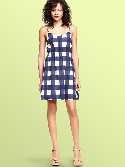 The most wearable little gingham dress that we'll dress up with espadrilles or down with cute sneakers.  Gap Gingham Linen Dress ($60)