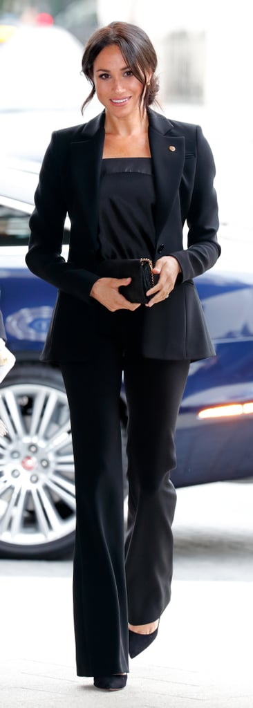 Meghan Markle Carrying a Stella McCartney Shaggy Deer Faux Leather Crossbody Bag in Black