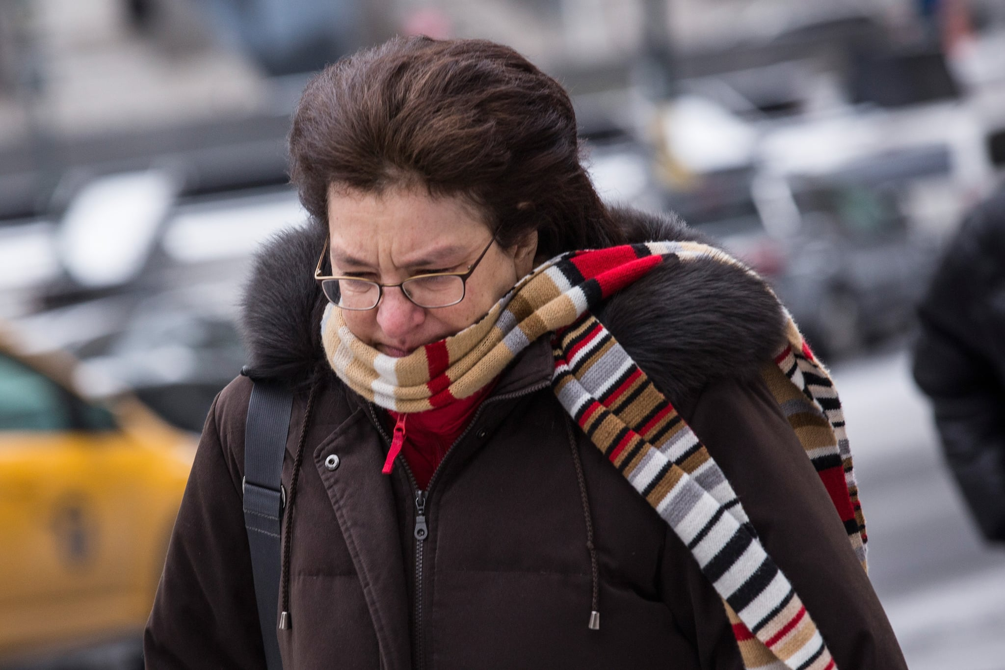 A woman braced herself against the chilly NYC winds.