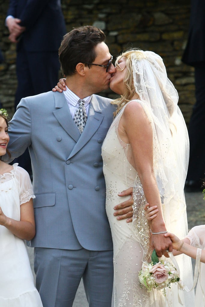 Kate and Jamie locked lips after tying the knot in Southrop, England, in July 2011.
