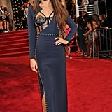 Selena Gomez struck a pose in a long-sleeve navy Atelier Versace gown with a bustier-style bodice and a thigh-high side slit.