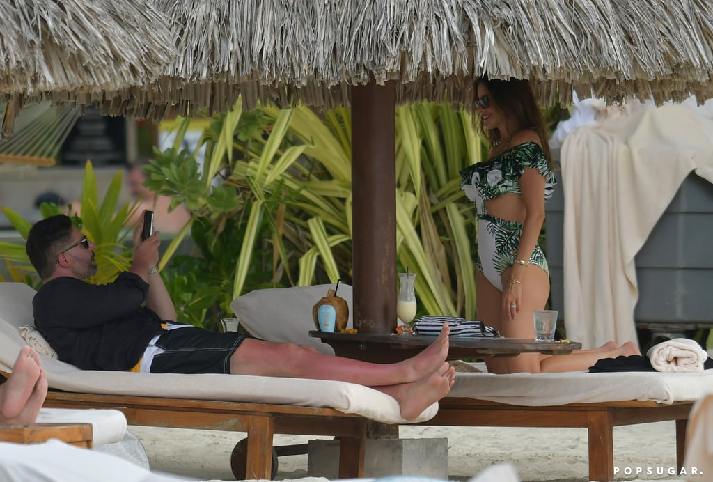 "Sofia Vergara and Joe Manganiello brought their love to Bora Bora on Christmas Day. The sexy stars were spotted relaxing on lounge chairs together at the Four Seasons Resort, enjoying some drinks and chatting with family. At one point, Joe snapped photos of his stunning wife in her palm-print swimsuit, which Sofia then checked on the phone to make sure she looked her best (which she most likely did). The couple, who recently rang in their one-year wedding anniversary, jetted off to French Polynesia last week to celebrate the holidays as well as Joe's 40th birthday. Sofia shared a photo of her handsome husband checking out the sunset on Wednesday, writing, ""My bday boy,"" while Joe tweeted a snap of Sofia enjoying the ocean that he captioned, ""Makes life easy when you wake up to this view.""      Related:                                                                See Sofia Vergara and Joe Manganiello's Stunning Wedding Pictures!                                                                   15 Photos of Joe Manganiello's Biceps, Presented Without Comment"