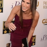 Sandra Bullock bent over laughing on the Critics' Choice Awards red carpet in LA.