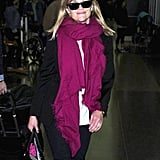 Reese Witherspoon smiled as she arrived at JFK in NYC.