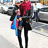 With son Flynn in hand, Miranda donned a mummy-on-the-go look with a Balenciaga quilted jacket, hot-pink pashmina, skinny jeans, Tabitha Simmons lace-up ankle boots, and a Prada bag adorned with floral appliqués.
