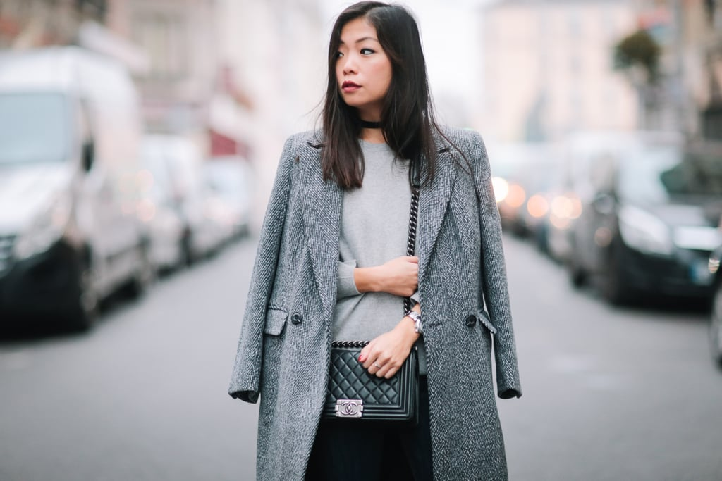 This neutral outfit spotted on the streets of Paris makes us only want to wear gray — with a black choker, that is.