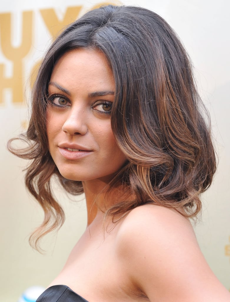 Mila Added A Touch Of Honey Highlights To Her Wavy Hair At The 2009