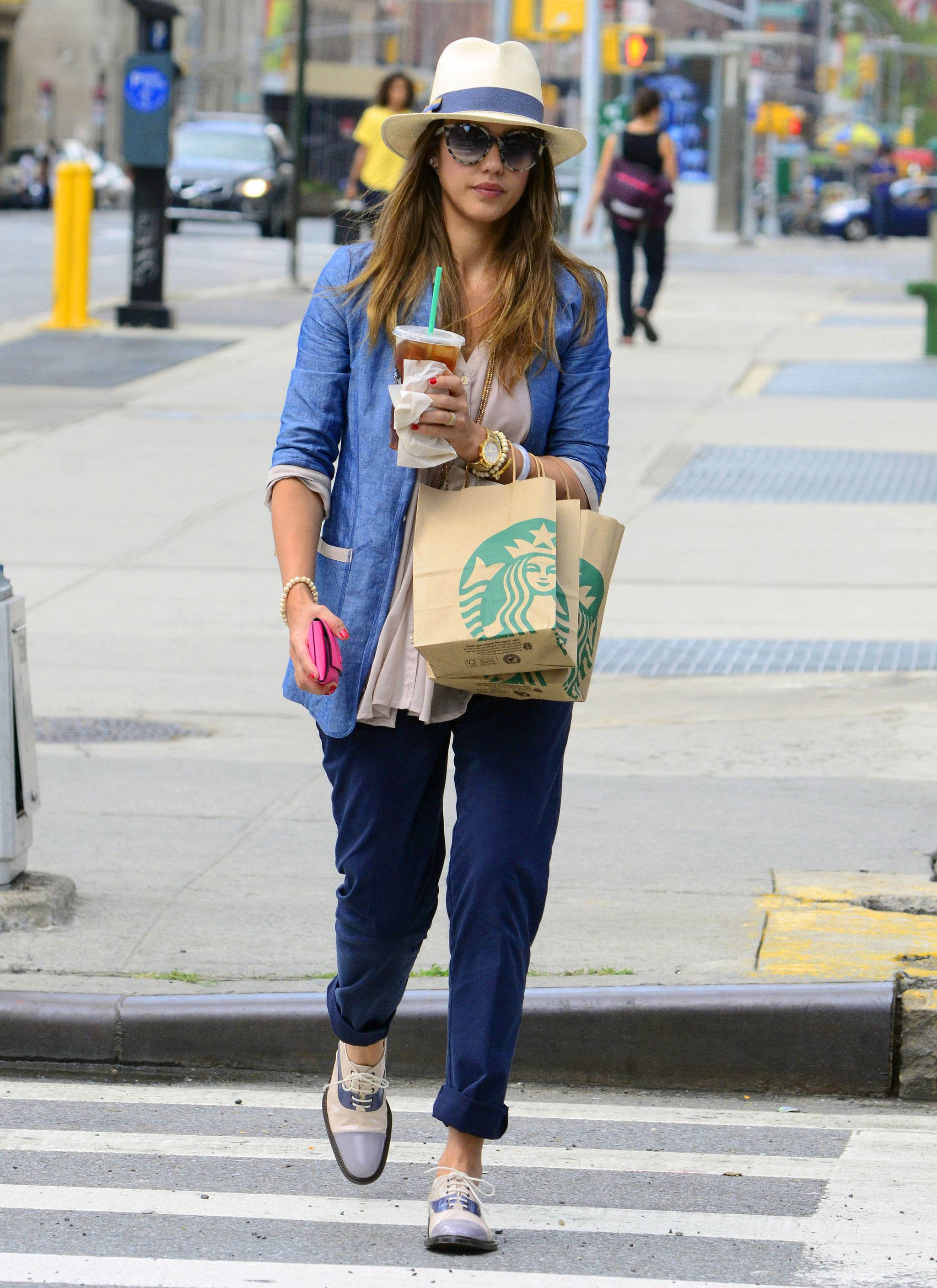 While strolling around NYC, Jessica accessorized her blue-on-blue look — chambray jacket and cuffed navy trousers — with a Tory Burch fedora, tie-dye shades, and tricolor patent oxfords.