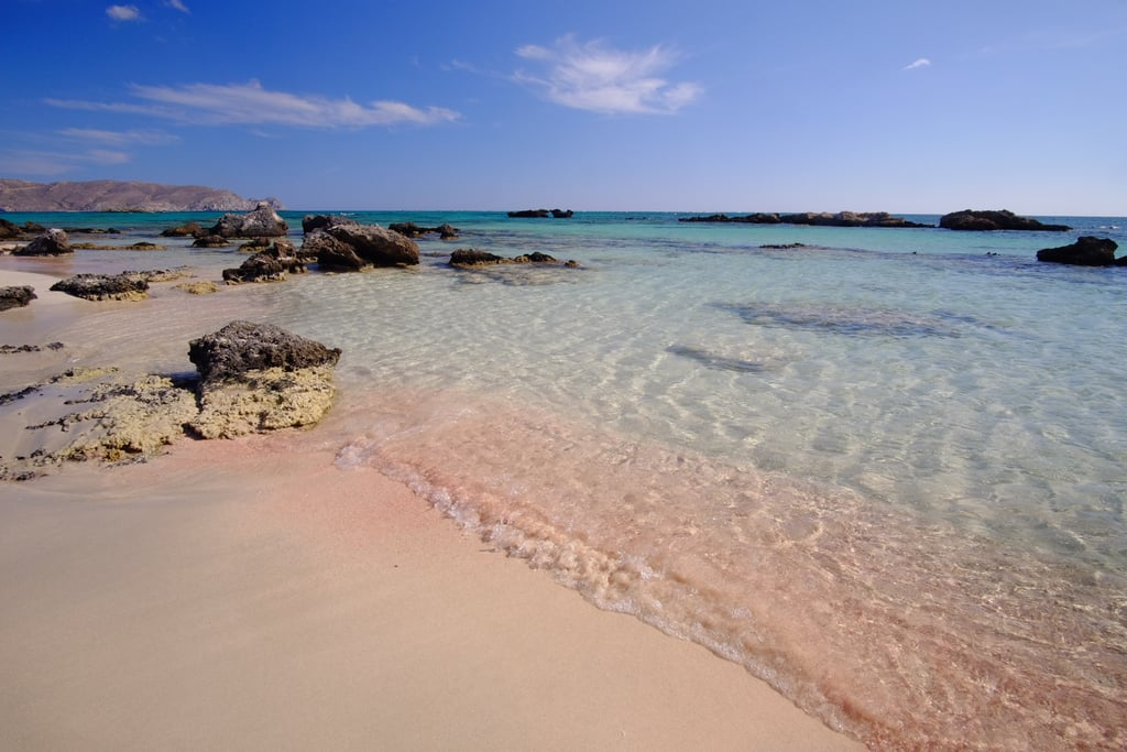 Be a mermaid at the pink-sanded Elafonissi Beach in Greece.