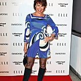 Novelist Kathy Lette worked a print dress and knee high boots.